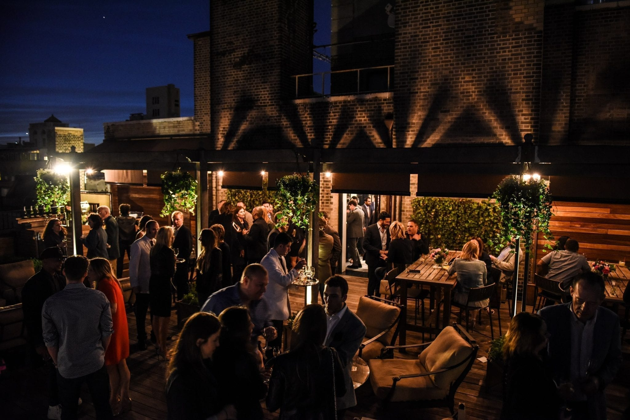The Surrey Hotel nightlife on the rooftop. The crowd is gathered for a rooftop launch party.