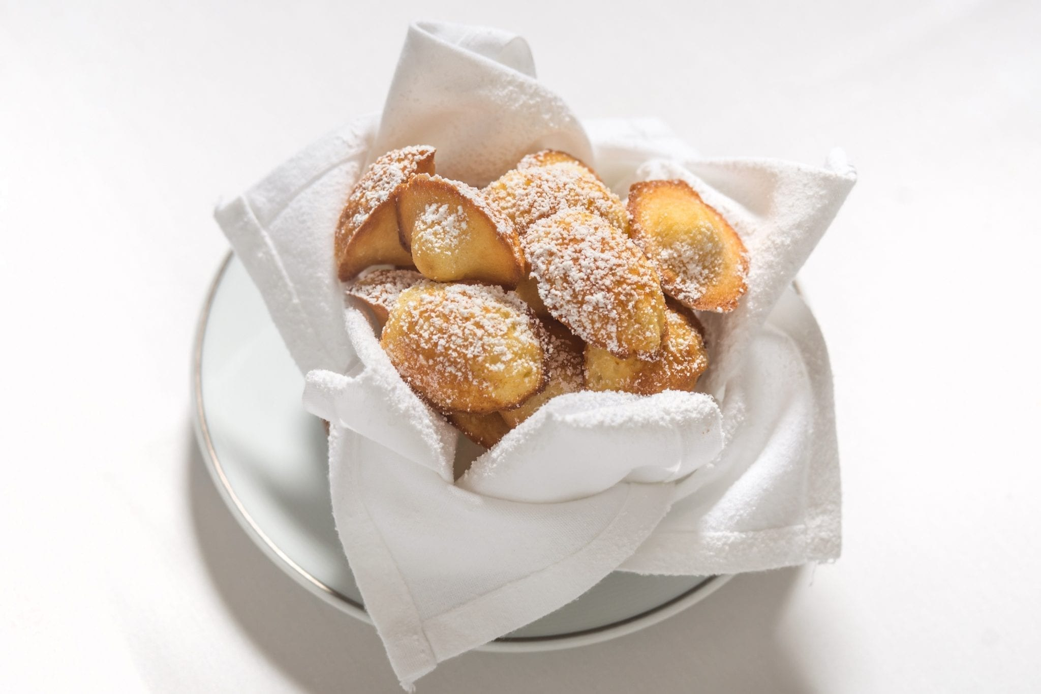 A small bowl of Madelienes, served from Cafe Boulud. Photograph by Paul Wagtouicz.