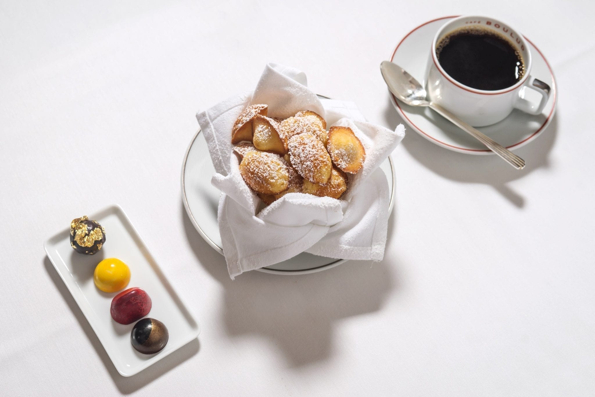 Pastries, Madelienes and coffee, served from Cafe Boulud. Photograph by Paul Wagtouicz.
