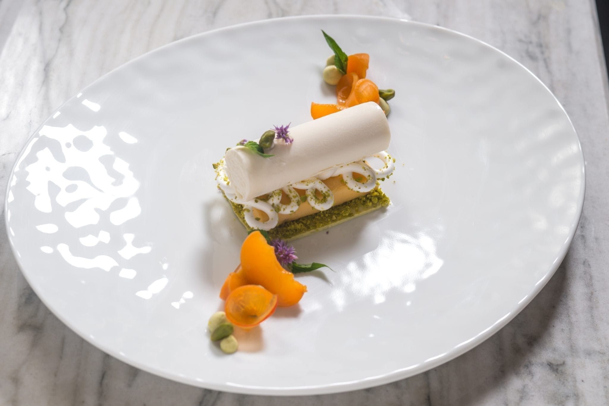 Fruit pastry on a plate, from Cafe Boulud. Photograph by Paul Wagtouicz.